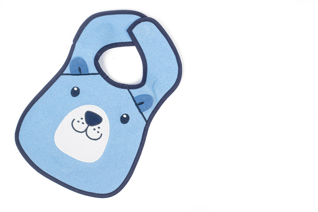 Beautiful Baby Bib above white background with copy space