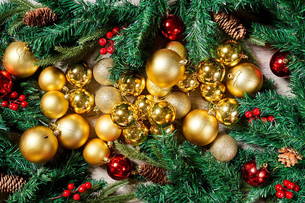 Beautiful Christmas background made of fir tree branches and golden colored baubles