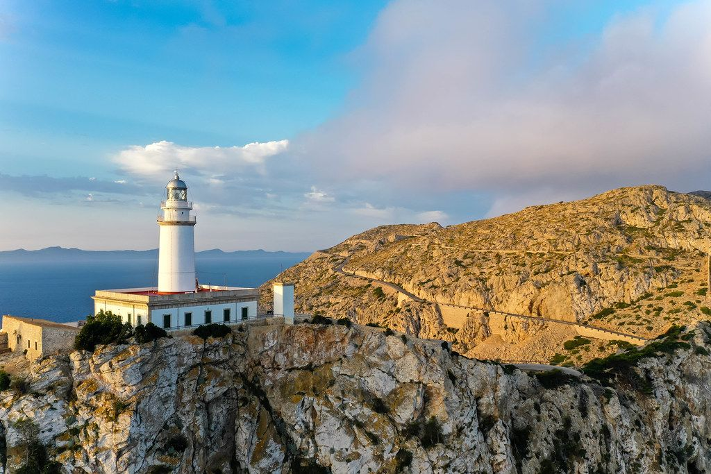 Beautiful light illuminates the lighthouse at Cap de Formentor (Mallorca) and the surrounding cliffs