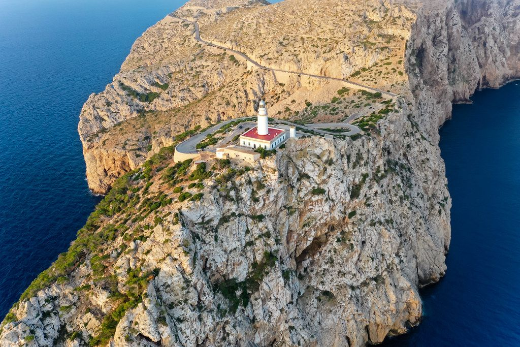 Beautiful Majorca: the rocky landscape of the Cap de Formentor headland with its lighthouse. Aerial view