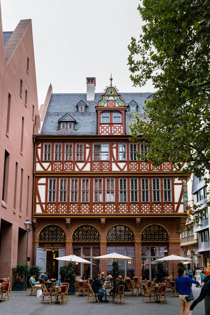 Beautiful old timber-framed house with a cafe near the Frankfurt Cathedral