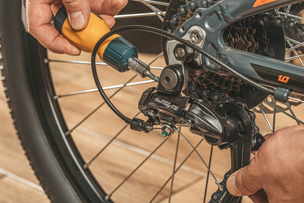 Bicycle repair with screwdriver, close up