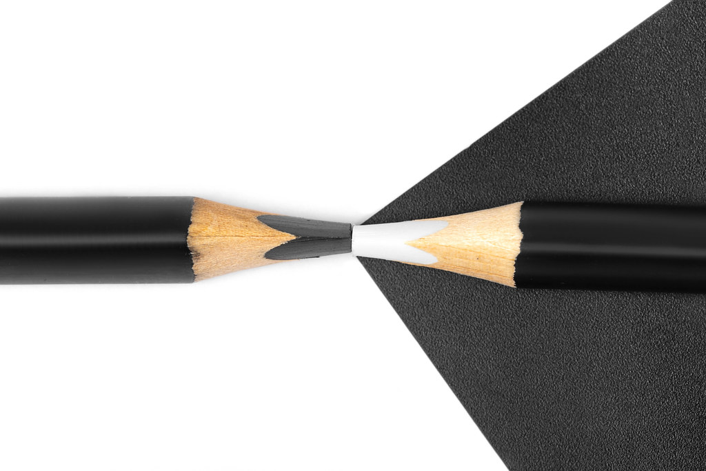 Black and white pencils - concept of business, opposite, contrast