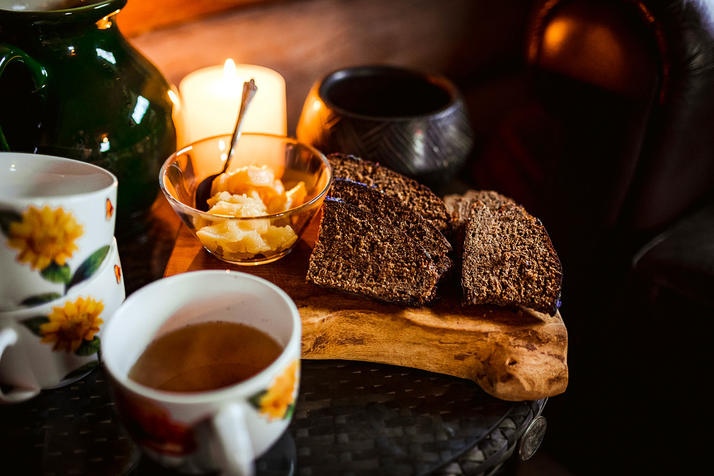 Black Bread Slices With Honey And Tea