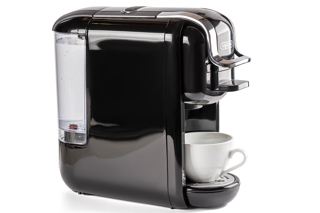 Black coffee machine with white cup