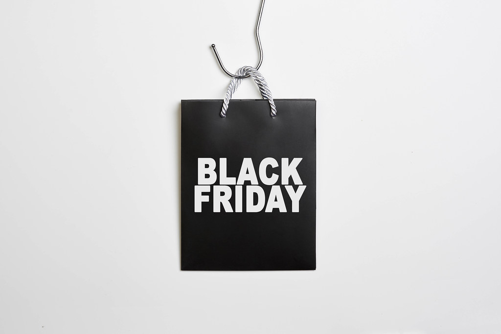 Black friday concept with bag shopping back on white