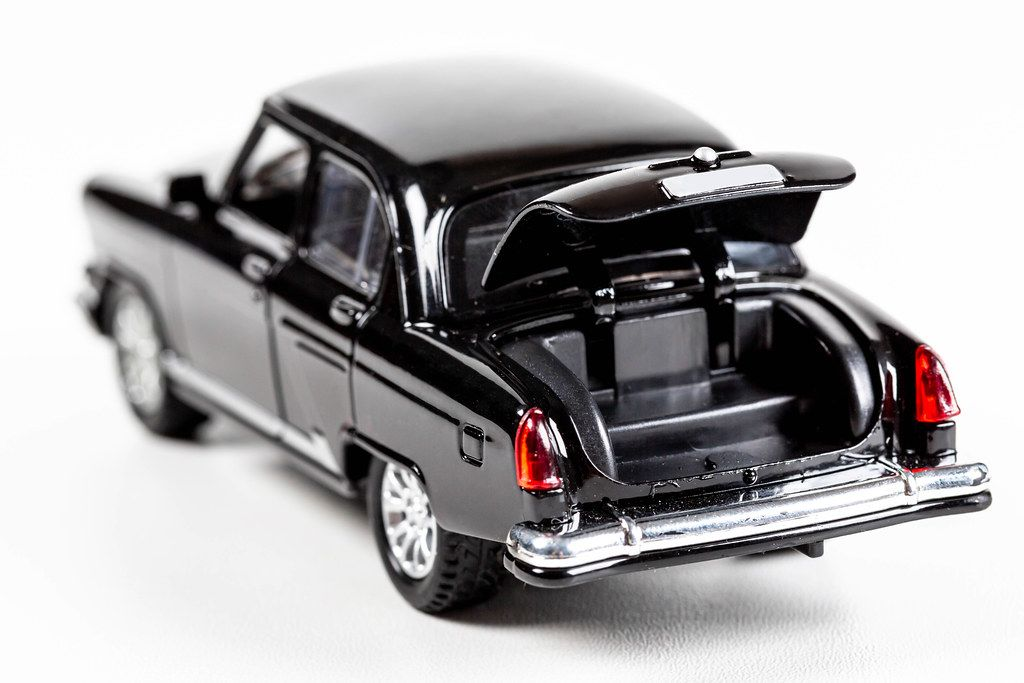 Black metal car model Volga with an open trunk