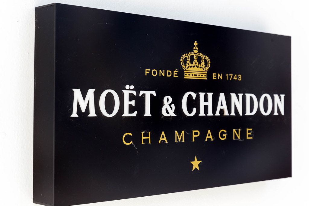 Black Moët & Chandon Champagne sign on white wall in Mykonos, Greece