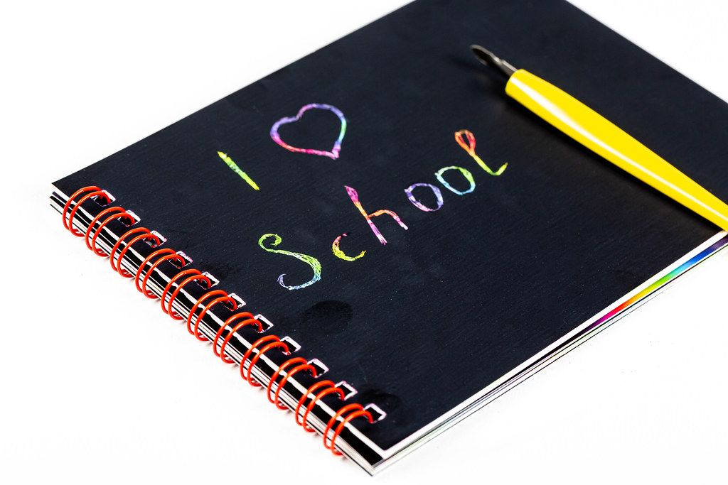 Black notebook with multicolored lettering - I love school