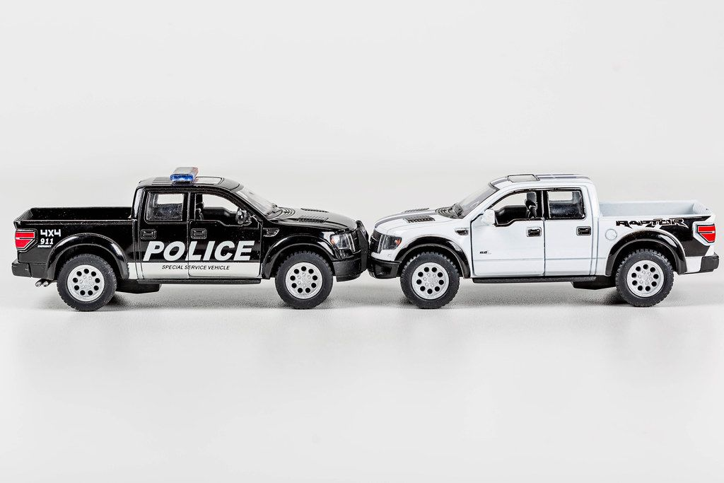 Black police and white metal Pickup car models