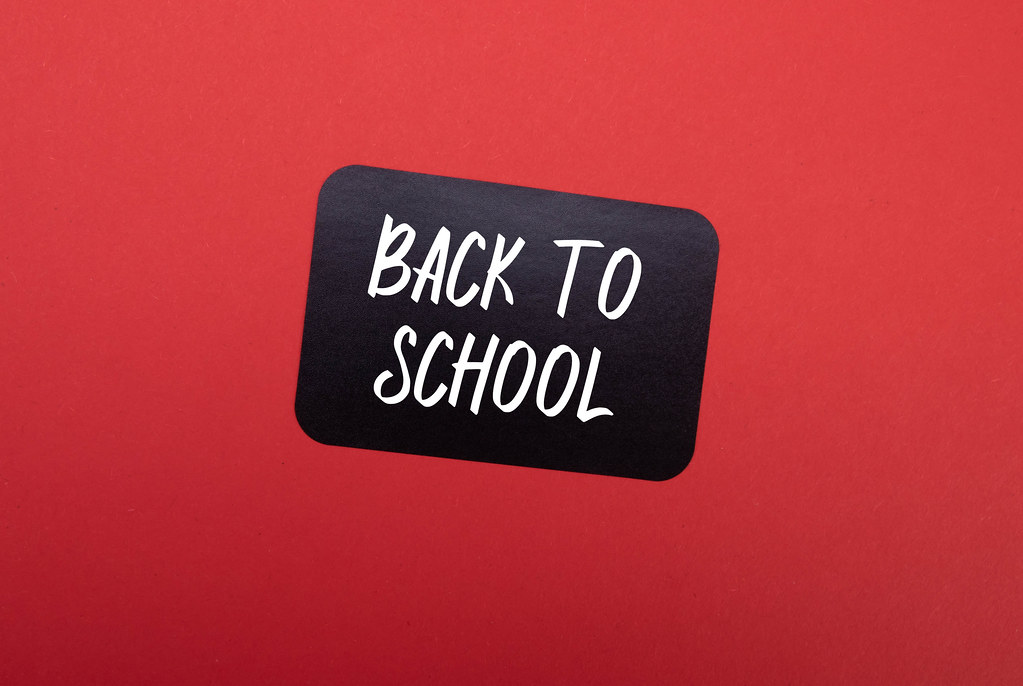 Black sticker with Back to School text on red background