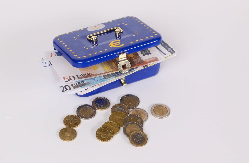 Blue metal cash box with Euro banknotes and coins