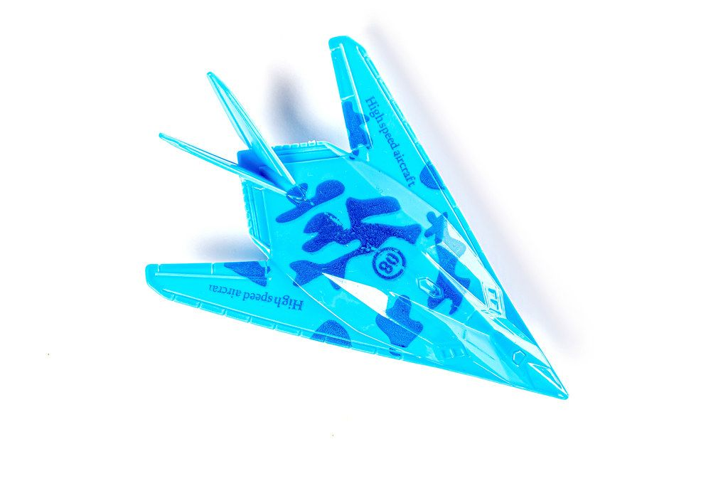 Blue plastic military aircraft on white