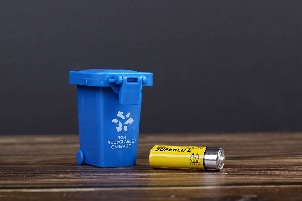 Blue recycle bin with battery