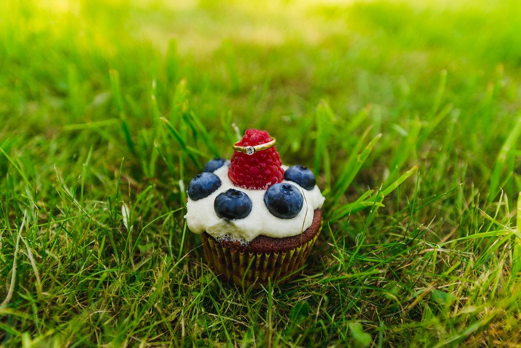 Blueberry Cupcake With Engagement Ring On The Grass