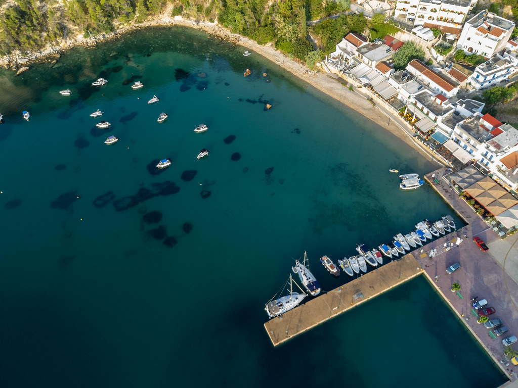 Boats anchored in the bay of Patitiri near the harbour on the Greek island of Alonnisos. Aerial view
