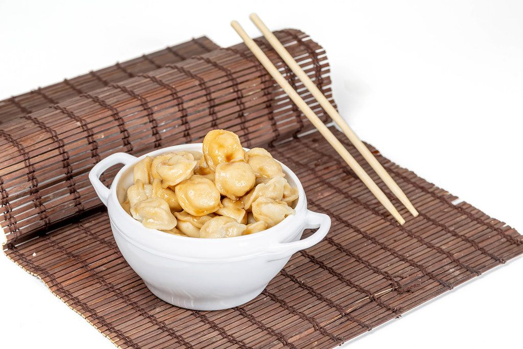 Boiled dumplings with soy sauce and butter