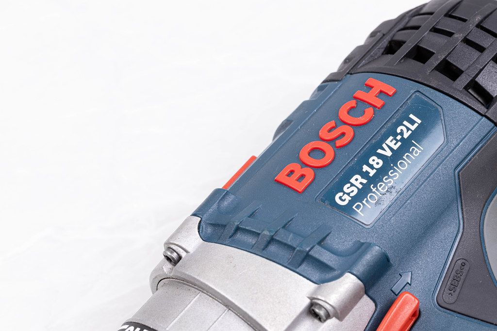 Bosch Acu drill with copy space above white background