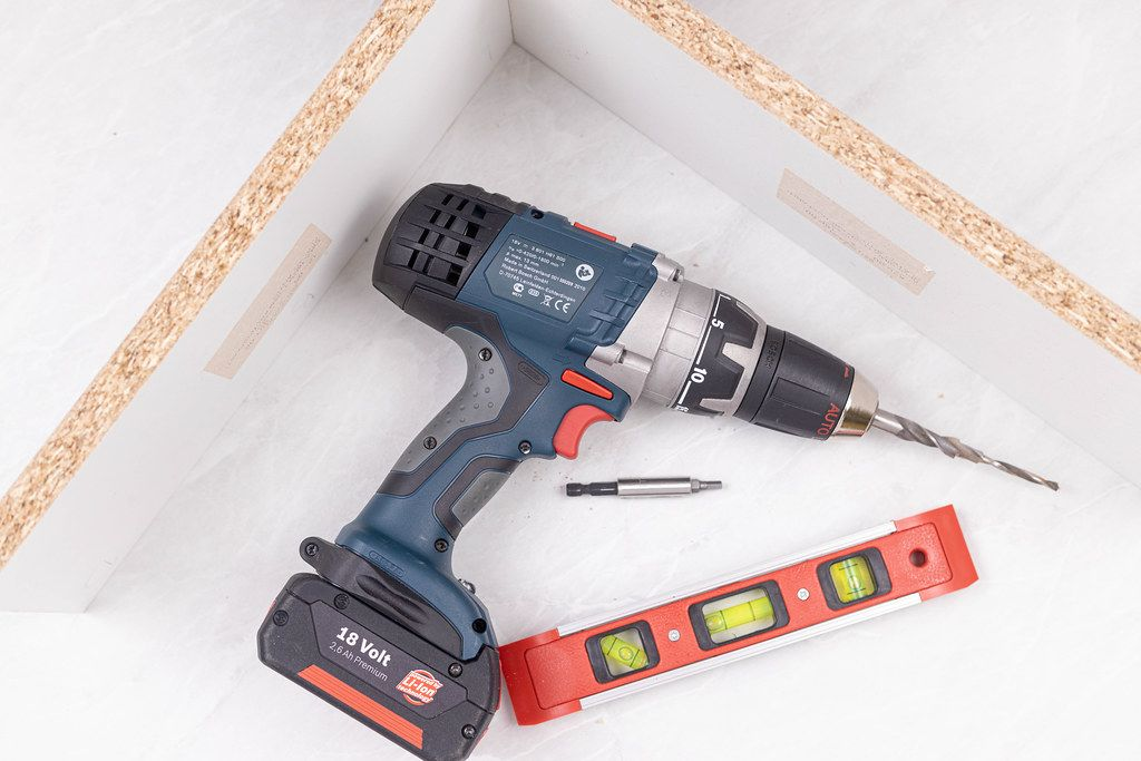 Bosch Acu drill with drill and level in workshop
