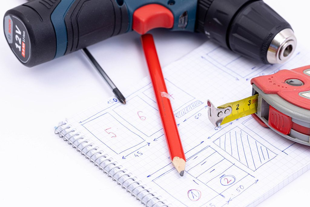 Bosch battery drill with Measuring Tape and Screwdrivers on the project sketch