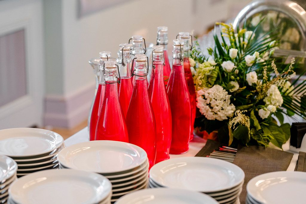 Bottles With Cranberry Juice On the Serving Table