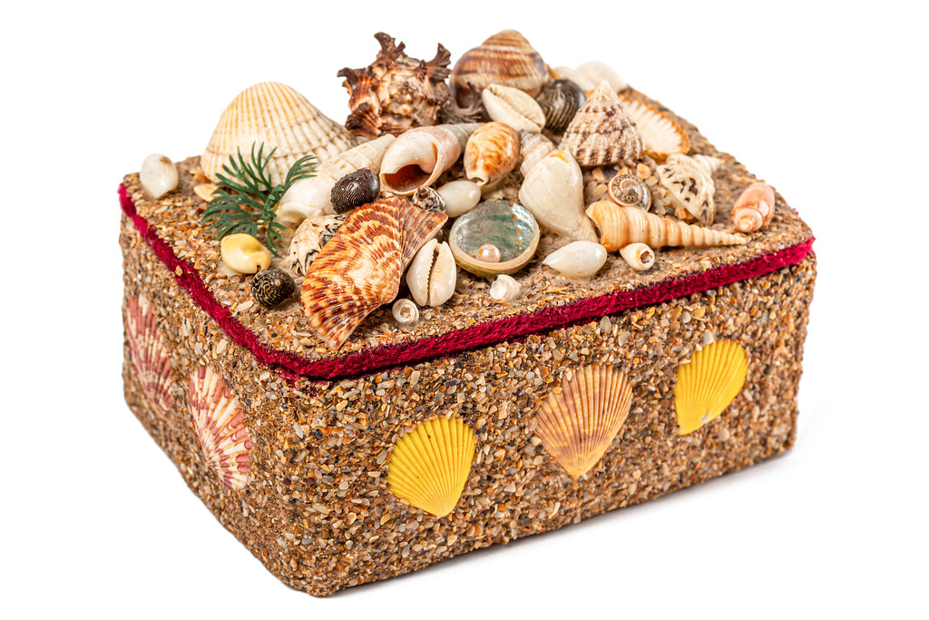 Box in a marine style decorated with seashells on a white background