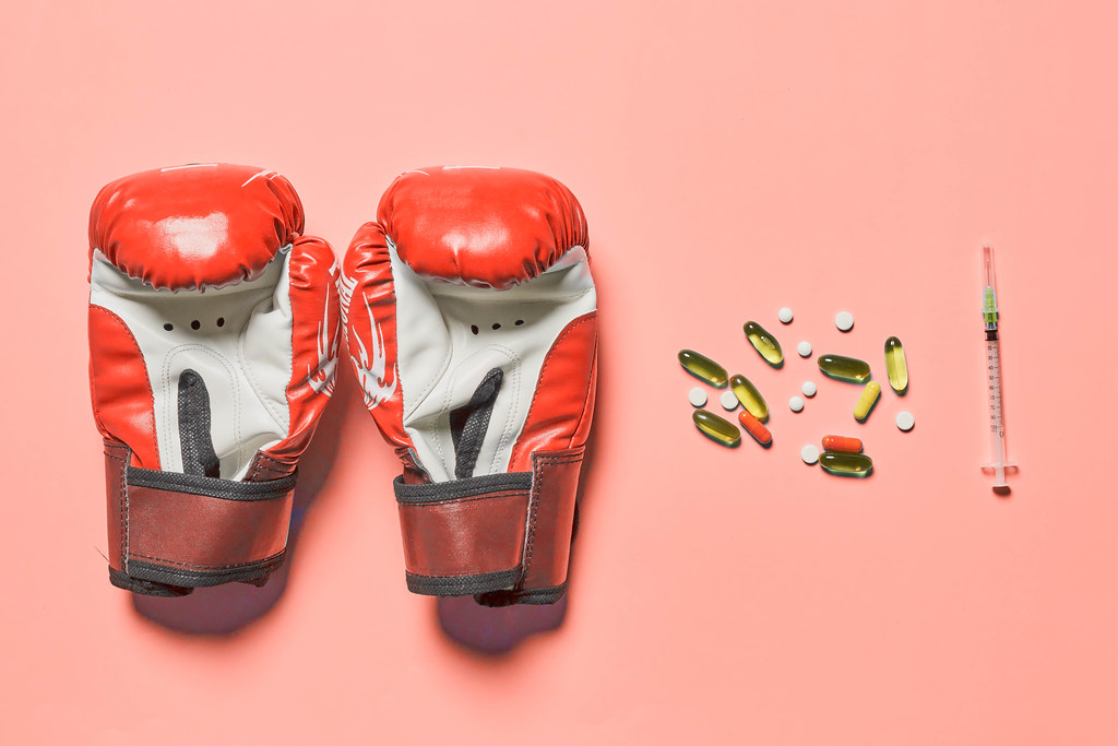Boxing gloves and stimulating sport drugs capsules and syringe with doping