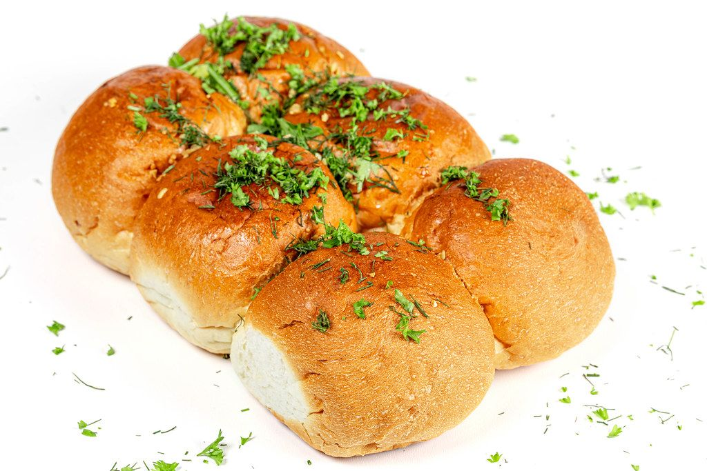 Bread with chopped parsley and dill with garlic on a white