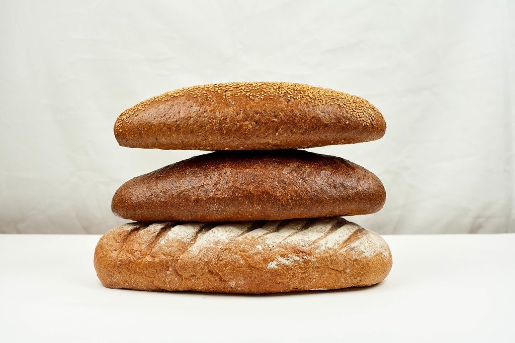 Bread's Pile. Different kinds of bread on white