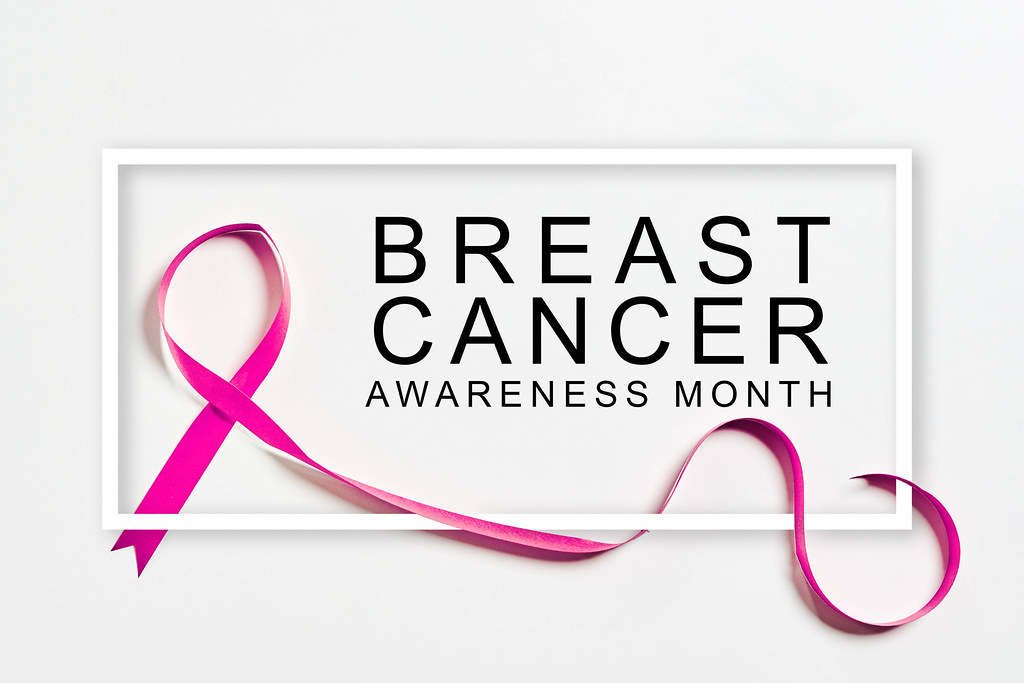 Breast cancer awareness month banner with pink ribbon