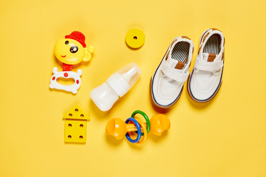 Bright baby boys set with toys, shoes and milk