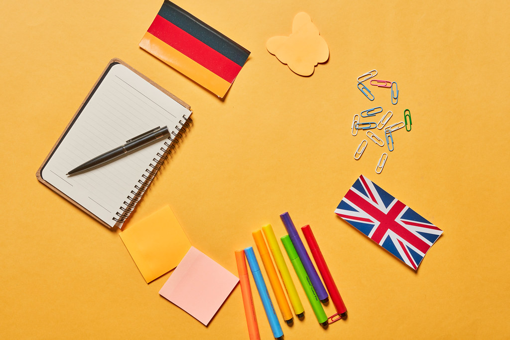 Bright educational background with school supplies