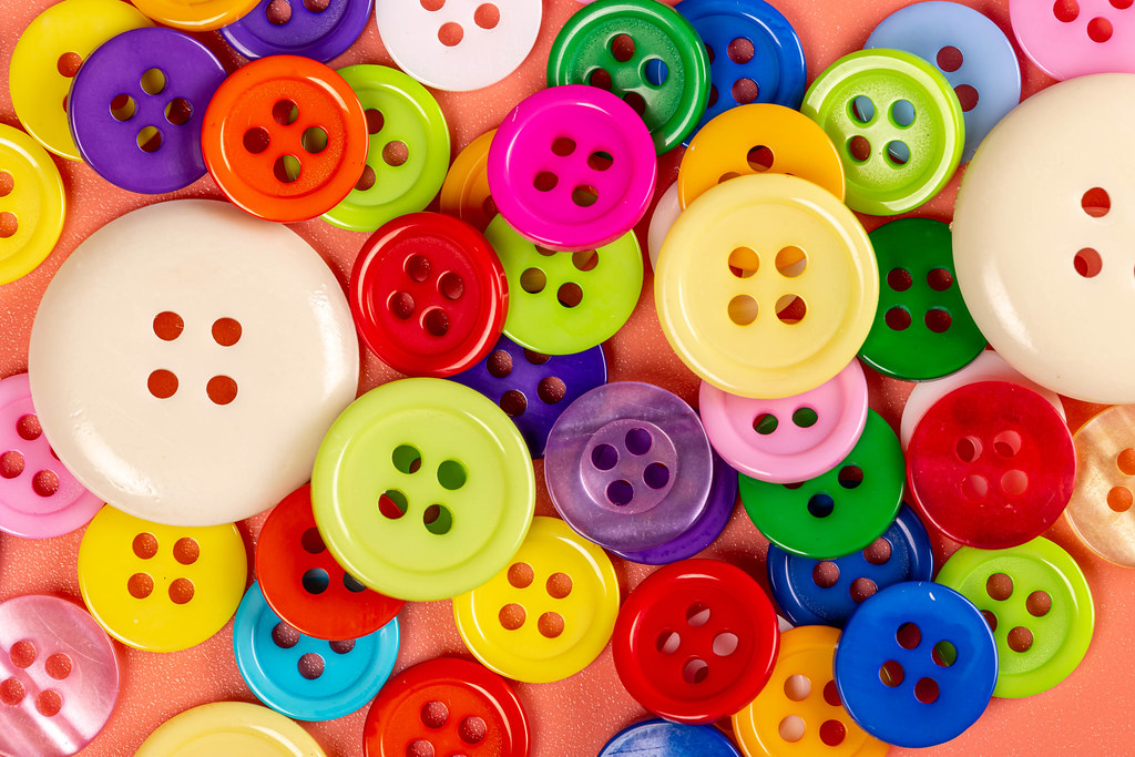 Bright multicolored buttons background, top view