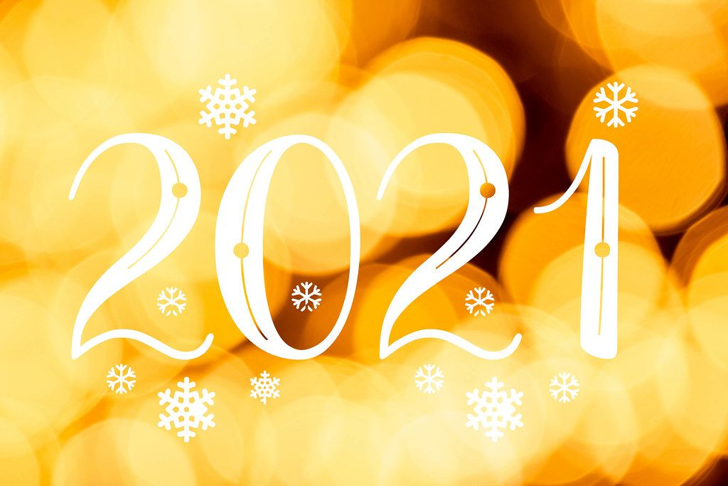 Bright yellow bokeh background, 2021 year greetings concept