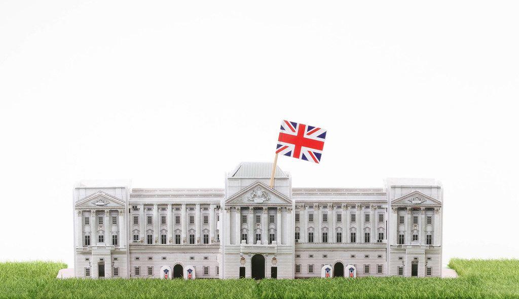 Buckingham Palace model house with UK flag
