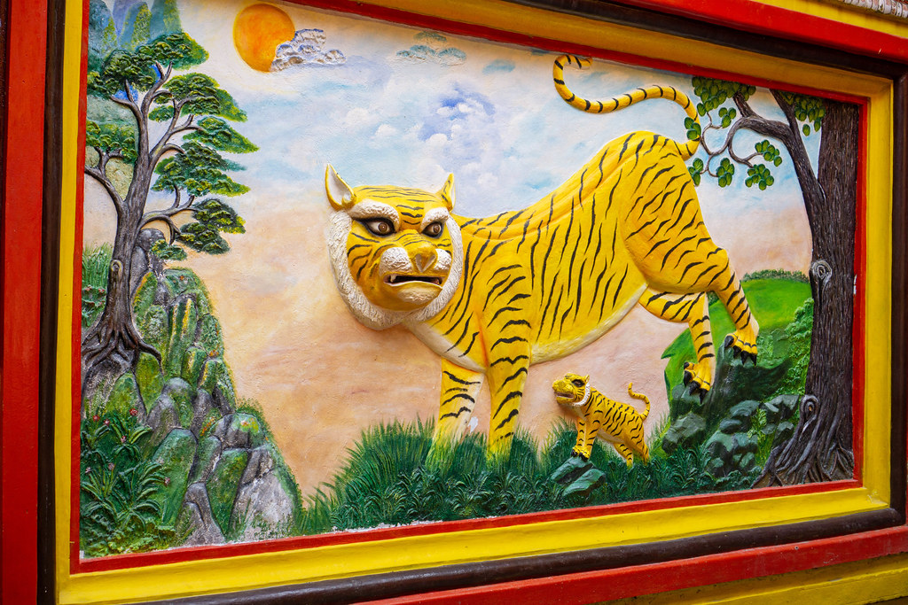 Buddhist 3D Wall Art of a Tiger in Nature with Trees in Quan Am Pagoda in District 5 of Ho Chi Minh City, Vietnam