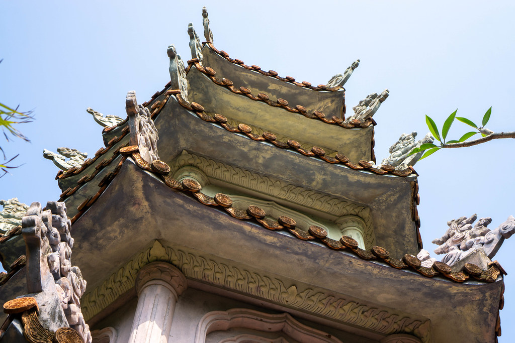 Buddhist Pagoda Tower with several Ornaments on Top of Marble Mountains in Da Nang, Vietnam