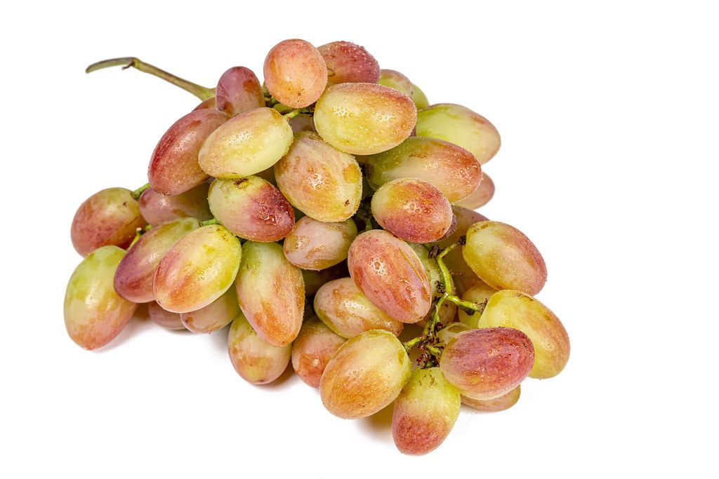 Bunch of fresh grapes on white