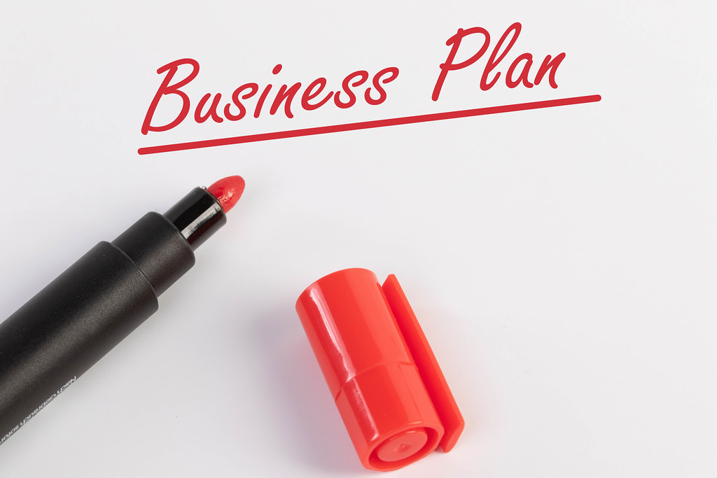 Business Plan text with red marker pen