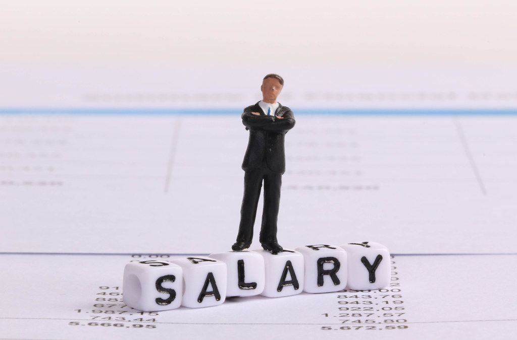 Businessman figure standing on Salary text