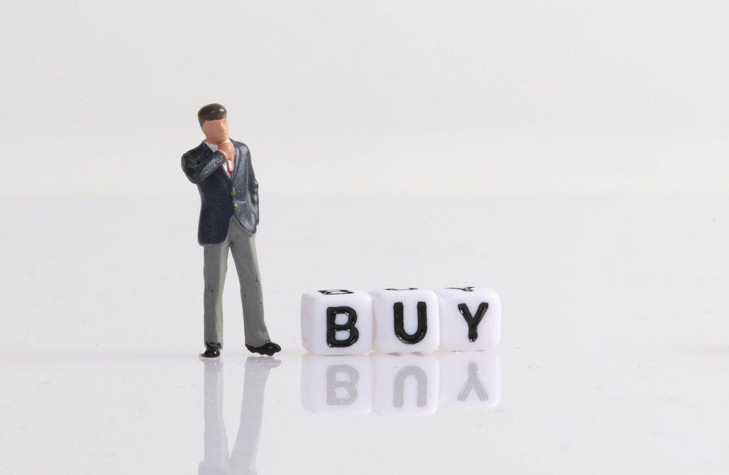 Businessman figure with Buy text