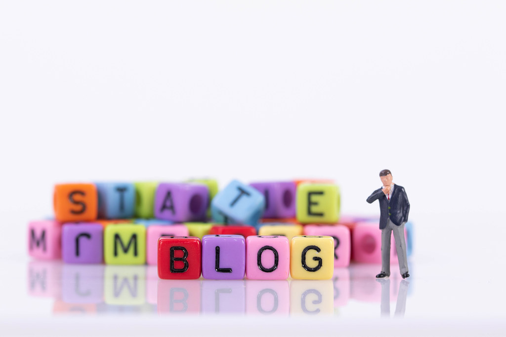 Businessman with colorful toy blocks with Blog text