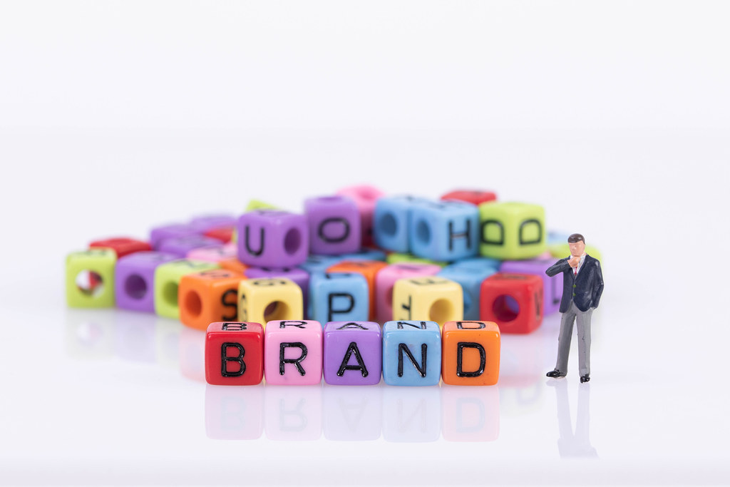 Businessman with colorful toy blocks with Brand text