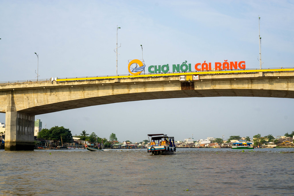 Cai Rang Floating Market Sign on a Bridge over the Mekong River with Tourist Boats in Can Tho, Vietnam