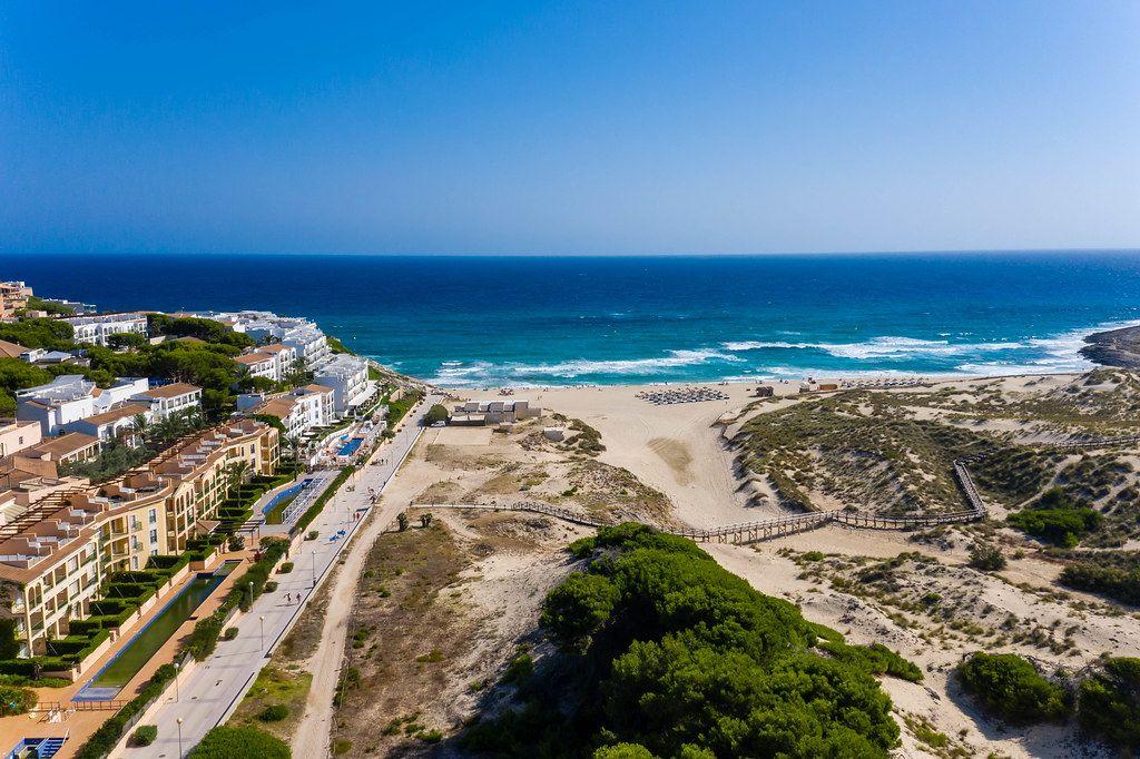 Cala Mesquida: sandy beach and buildings near Capdepera on Mallorca, Balearic islands. Drone pic