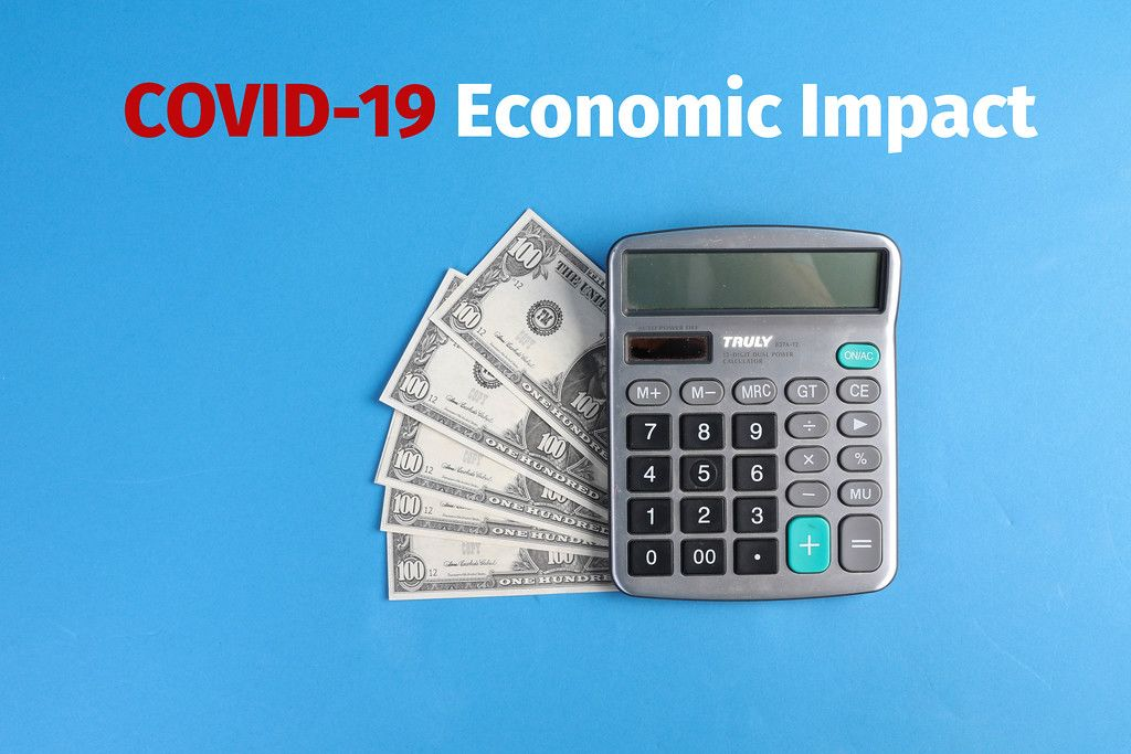 Calculator with money and COVID-19 Economic Impact text