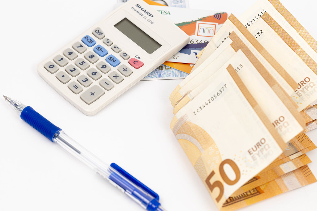 Calculator with Visa cards and Euro currency on the table