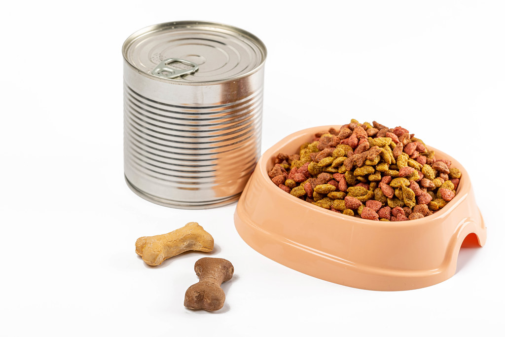 Canned food with pet food with dry food on white background