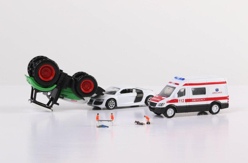 Car crash and paramedics on white backgorund