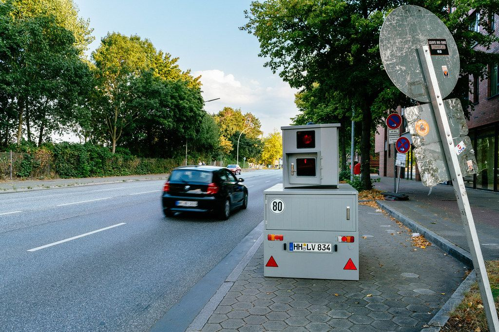 Car has passed portable speed radar box on the side of the street